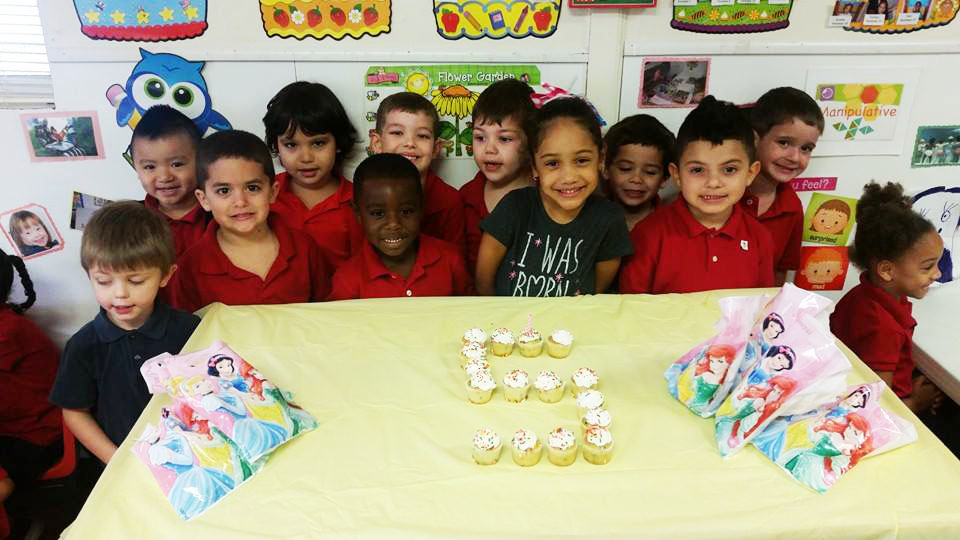Children Around a Birthday Cake